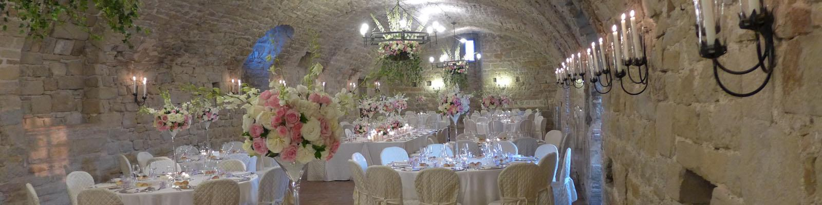 The Arms Hall decorated for a wedding in pink and white